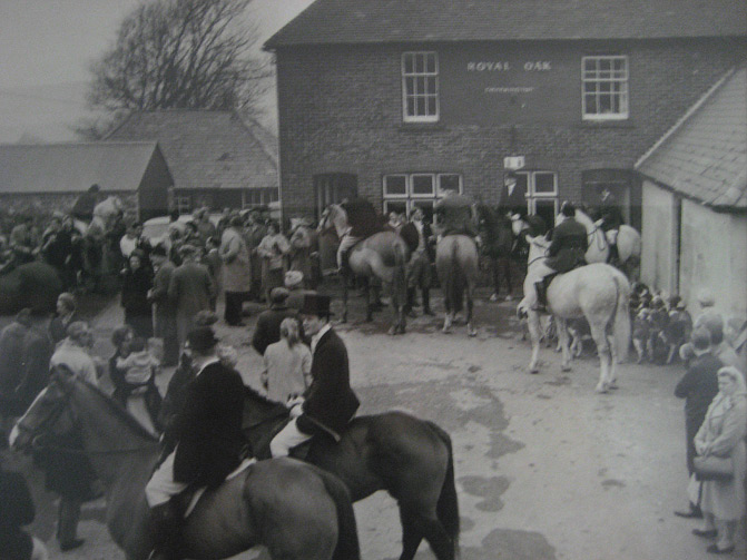 A hunt preparing to set off from The Royal Oak in the early 60s
