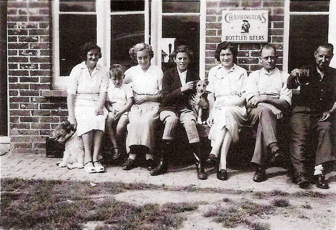 Outside the front of The Royal Oak, 1949 Landlord Fred Aspin (2nd from r), his wife Phyllis (3rd from r) and their daughter Aline (4th from r)